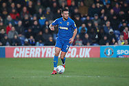 AFC Wimbledon defender Luke O'Neill (2) dribbling during the EFL Sky Bet League 1 match between AFC Wimbledon and Doncaster Rovers at the Cherry Red Records Stadium, Kingston, England on 14 December 2019.