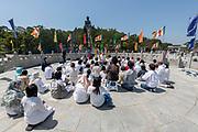 Young people vorship the Big Buddah at Lantau Island, Hong Kong, China.