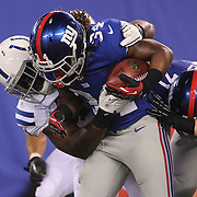 Laron Scott, New York Giants, is tackled during the New York Giants V Indianapolis Colts, NFL American Football Pre Season match at MetLife Stadium, East Rutherford, NJ, USA. 18th December 2013. Photo Tim Clayton
