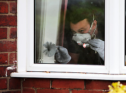 Licensed to London News Pictures. 15/05/2014. North Shields, Tyne & Wear, UK. Crime Scene Investigators from North Yorkshire Police enter their third day making a forensic examination of 82 Holywell Road, North Shields, in connection with the investigation into the disappearance of Claudia Lawrence and the arrest and subsequent bailing of a 59 year-old York man suspected of her murder. Photo credit: Adrian Don/LNP