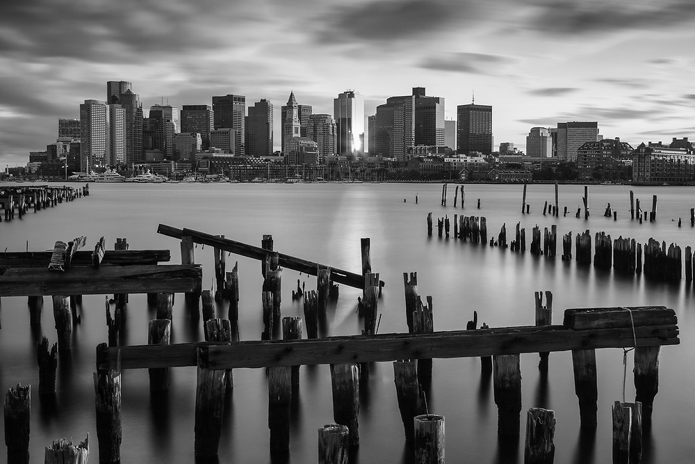 Scenic Boston Harbor skyline photography featuring landmarks such as the Marriott Hotel or Custom House of Boston and One International Place photographed on a magnificent sunset night. <br /> <br /> Photos of Boston Harbor are available as museum quality photography prints, canvas prints, acrylic prints or metal prints. Fine art prints may be framed and matted to the individual liking and decorating needs: <br /> <br /> https://juergen-roth.pixels.com/featured/boston-harbor-waterfront-juergen-roth.html<br /> <br /> Boston stock photography image licensing available at www.RothGalleries.com.<br /> <br /> Good light and happy photo making!<br /> <br /> My best,<br /> <br /> Juergen<br /> Licensing and Prints: http://www.rothgalleries.com<br /> Instagram: https://www.instagram.com/rothgalleries<br /> Twitter: https://twitter.com/naturefineart<br /> Facebook: https://www.facebook.com/naturefineart