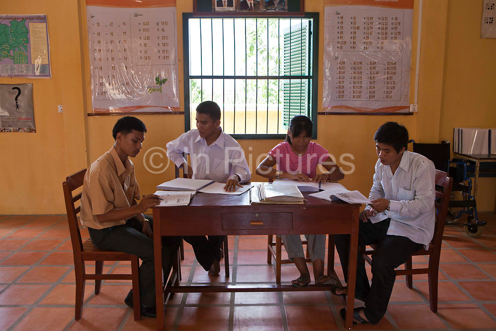 Tim and Sinath, blind students, proof reading Braille schoolbooks at the Krousar Thmey School for Deaf and Blind children in Phnom Penh. The Krousar Thmey Foundation assists underprivileged children across Cambodia.