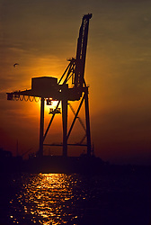 Stock photo of the silhouette of a jack up rig on the ocean