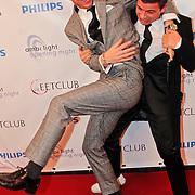 NLD/Amsterdam/20101115 - Premiere De Eetclub, Robert de Hoog vechtend met Geza Weisz