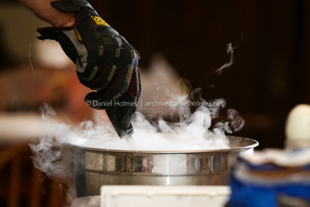 (8/22/14, FRANKLIN, MA) Scientist Chris Towle makes ice cream with liquid nitrogen at the Franklin library on Friday. Daily News and Wicked Local Photo/Dan Holmes