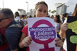 September 29, 2018 - SãO Paulo, São Paulo, Brazil - SAO PAULO SP, SP 29/09/2018 BRAZIL-ELECTION-BOLSONARO-WOMEN-PROTESTB: Women protest against the far-right's presidential candidate on September 29, 2018 in Sao Paulo, Brazil. The protests occurred simultaneously in several Brazilian cities, against Jair Bolsonaro, the far right's presidential candidate. Protests included an internet campaign (#elenão and #himnot) which was joined by many women from various countries. Corinthians fans, Brazil's biggest soccer team, and other social groups also joined. (Credit Image: © Cris Faga/ZUMA Wire)