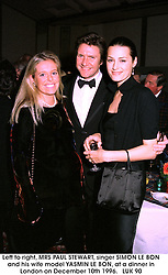 Left to right, MRS PAUL STEWART, singer SIMON LE BON and his wife model YASMIN LE BON, at a dinner in London on December 10th 1996.   LUK 90