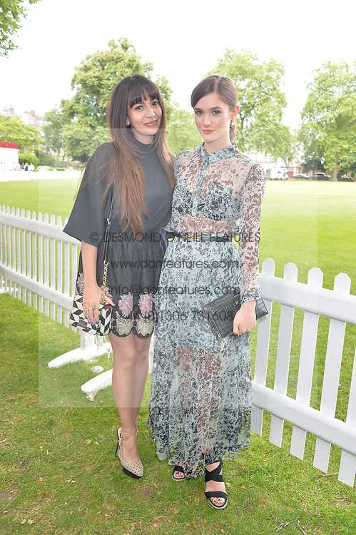 Left to right, ZARA MARTIN and SAI BENNETT at the Flannels for Heroes Cricket tournament in association with Dockers in aid of the charities Walking With The Wounded, On Course Foundation and Combat Stress held at Burton Court, London on 20th June 2014.