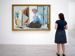 Woman looking at painting Femme au Miroir ( Femme accroupie) by Pablo Picasso at art museum K20 or Kunstsammlung at Grabbeplatz Dusseldorf Germany