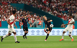 March 23, 2018 - Miami Gardens, Florida, USA - Croatia midfielder Ivan Rakitic (7) kicks the ball past Peru forward Jefferson Farfan (10) during a FIFA World Cup 2018 preparation match between the Peru National Soccer Team and the Croatia National Soccer Team at the Hard Rock Stadium in Miami Gardens, Florida. (Credit Image: © Mario Houben via ZUMA Wire)