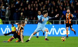 David Silva of Manchester City skips past Michael Dawson of Hull City - Mandatory by-line: Matt McNulty/JMP - 26/12/2016 - FOOTBALL - KC Stadium - Hull, England - Hull City v Manchester City - Premier League