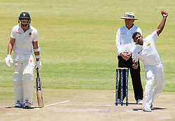 Sri Lanka captain Rangana Herath in action as Zimbabwe batsman and captain Graeme Cremer looks on during the third day of the 100th test match for Zimbabwe played in a series of two matches with Sri Lanka at Harare Sports Club 31 October 2016.