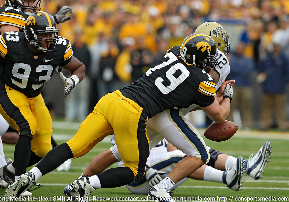September 17, 2011: Pittsburgh Panthers quarterback Tino Sunseri (12) fumbles the ball after being hit by Iowa Hawkeyes defensive lineman Dominic Alvis (79) during the first half of the game between the Iowa Hawkeyes and the Pittsburgh Panthers at Kinnick Stadium in Iowa City, Iowa on Saturday, September 17, 2011. Iowa defeated Pittsburgh 31-27.