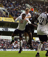 Photo: Chris Ratcliffe.<br /> Tottenham Hotspur v Portsmouth. The Barclays Premiership. 01/10/2006.<br /> Sol Campbell (R) of Portsmouth clashes with Michael Dawson andTom Huddlestone of Spurs. Dawson and Huddlestone were both injured with Dawson carried off with suspected concusion