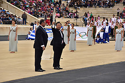 October 31, 2017 - Athens, Attiki, Greece - President of the Hellenic Olympic Committee Spyros Capralos (left) has handover the Tourch with the Olympic Flame to the President of the Organising Committee for the XXIII Winter Olympics Games 'PYEONGCHANG 2018' Lee Hee Beom (right). The Handover Ceremony of the Olympic Flame for Winter Games PYEONGCHANG 2018, took place today in Panathenaic Stadium in the presence of the President of Hellenic Republic Prokopis Pavlopoulos. (Credit Image: © Dimitrios Karvountzis/Pacific Press via ZUMA Wire)