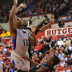 Seton Hall Pirates forward Herb Pope (15) charges Rutgers Scarlet Knights guard Eli Carter (5) during first half Big East NCAA Basketball between the Rutgers Scarlet Knights and Seton Hall Pirates at the Louis Brown Athletic Center. Rutgers leads Seton Hall 28-26 at halftime.