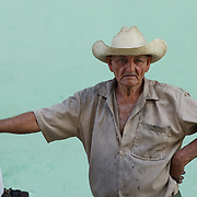 A local Cuban man that was selling coal, stops for a moment  on the streets of Trinidad, Cuba.