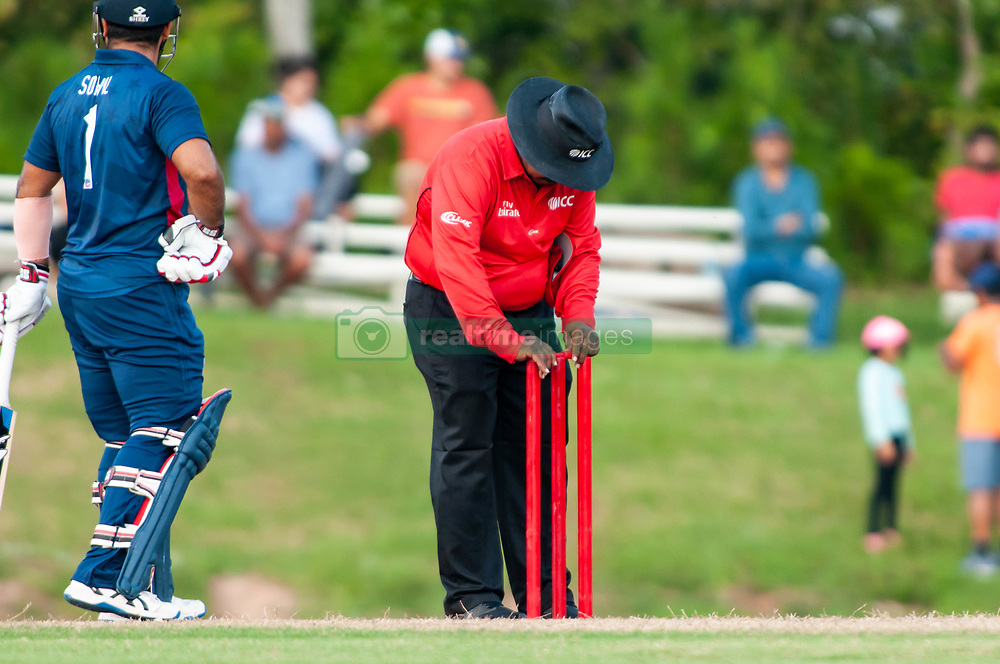September 22, 2018 - Morrisville, North Carolina, US - Sept. 22, 2018 - Morrisville N.C., USA - An official replaces the bails on top of the stumps during the ICC World T20 America's ''A'' Qualifier cricket match between USA and Canada. Both teams played to a 140/8 tie with Canada winning the Super Over for the overall win. In addition to USA and Canada, the ICC World T20 America's ''A'' Qualifier also features Belize and Panama in the six-day tournament that ends Sept. 26. (Credit Image: © Timothy L. Hale/ZUMA Wire)