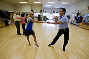 Dance instructor Jesse Desoto instructs some of his clients at the Fred Astaire Dance Studio in Buffalo Groove, Chicago, Illinois. (Jesse Desoto is one of the people interviewed for the book What I Eat: Around the World in 80 Diets.)