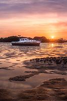 Abandoned boat at sunset in Cedar Key, FL