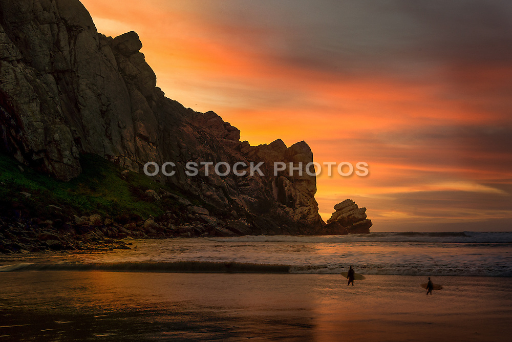 Surfers at Morro Rock During Sunset in Morro Bay California