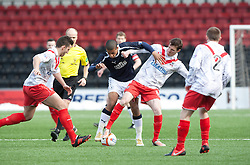 Falkirk's Lyle Taylor and Airdrie United's Sean Lynch..half time : Airdrie United 0 v  0 Falkirk, 30/3/2013..©Michael Schofield..