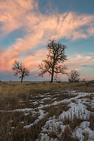 After the sun went down, the entire sky lit up with colorful orange and pink clouds. This was at Mallard's Landing next to the Bighorn River in Montana.
