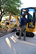 Nichole confers with Brian, owner of Big Truck, before he begins excavating in my front yard.