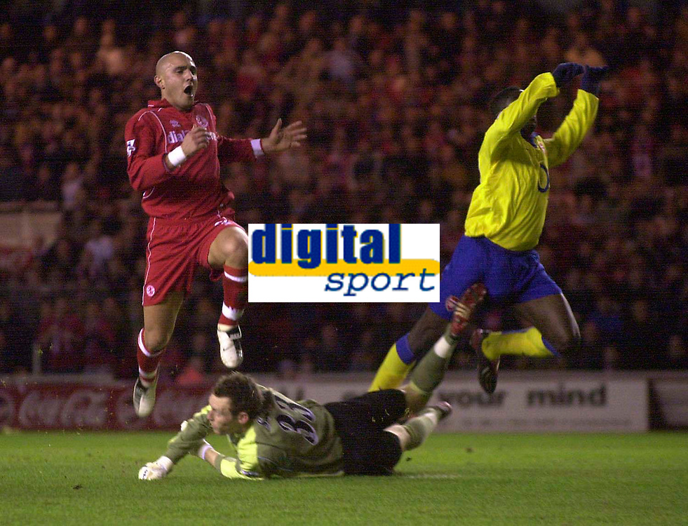 Fotball<br /> Middlesbrough v Arsenal. Carling Cup semi final second leg. <br /> Riverside Stadium, Middlesbrough. 03/02/2004.<br /> Boro's Massimo Maccarone (L) comes agonisingly close to putting Boro in front, sending a shot past Arsenal keeper Graham Stack (C).
