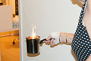 Mature woman burns essence to ward off evil spirits and cleanse the home before moving in