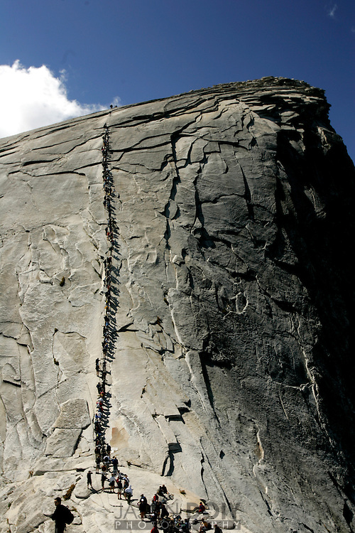 The final leg of the Half Dome is 300 yards of steel cables at a 45 degree angle in the steepest section..Deb Mosley undertook a 20 mile, 12 hour climb to the top of Half Dome on September 10. The climb raised money for five local breast cancer organizations...photo by Jason Doiy.9-15-05.037-2005
