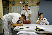 Officers inside the Yamagiri ship. <br /> Miho Ootani, the first woman destroyer captain of Japan's Marine Self Defence Forces (MSDF), on board the Yamagiri in Yokosuka army base near Tokyo.