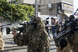 October 4, 2018 - Gaza City, The Gaza Strip, Palestine - Palestinian members of Al-Quds Brigades, the military wing of the Islamic Jihad group, march with their weapons to show loyalty for the Iranian-backed Palestinian movement's newly elected leader Ziad al-Nakhalah during a rally along the streets of Gaza, Thursday, Oct. 4, 2018. (Credit Image: © Mahmoud Issa/Quds Net News via ZUMA Wire)