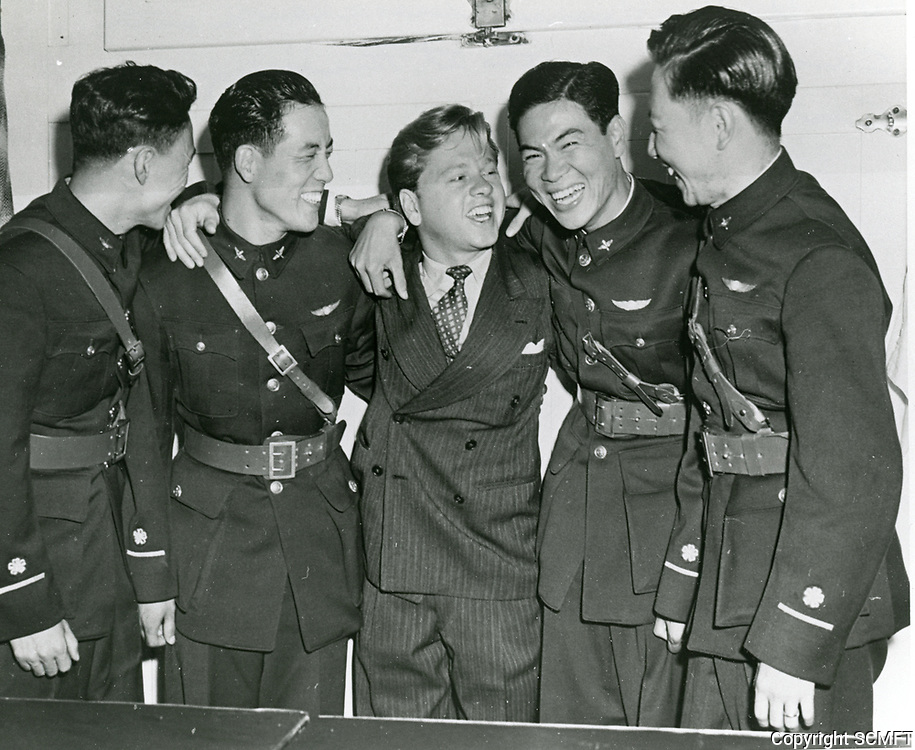 1944 Mickey Rooney jokes with visiting Chinese Air Cadets at the Hollywood Canteen.