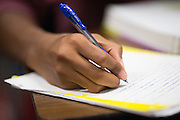 Junior Tawfik Yassin works out AP Psychology homework during the EOS tutoring class during lunch at Milpitas High School in Milpitas, California, on October 13, 2014. (Stan Olszewski/SOSKIphoto)
