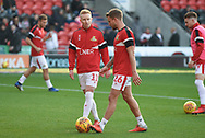Ali Crawford of Doncaster Rovers (11) in conversation with James Coppinger of Doncaster Rovers (26) during the warm up during the EFL Sky Bet League 1 match between Doncaster Rovers and AFC Wimbledon at the Keepmoat Stadium, Doncaster, England on 17 November 2018.