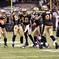 2009 November 30: New Orleans Saints safety Darren Sharper (42) celebrates with teammates after intercepting a pass during a 38-17 win by the New Orleans Saints over the New England Patriots at the Louisiana Superdome in New Orleans, Louisiana.