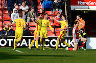 Will Grigg celebrates scoring the equaliser during the Sky Bet League 1 match between Walsall and Milton Keynes Dons at the Banks's Stadium, Walsall, England on 14 March 2015. Photo by Alan Franklin.