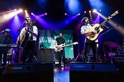 © Licensed to London News Pictures. 12/11/2013. London, UK.   Hudson Taylor performing live at The Forum, supporting headliner Kodaline. In this pic - Alfie Hudson-Taylor (left) and Harry Hudson-Taylor (right).  Hudson Taylor (previously Harry & Alfie) are an Irish folk pop duo formed in 2011. The duo consists of brothers Alfie and Harry.   Photo credit : Richard Isaac/LNP