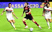 SAO PAULO, BRAZIL - FEBRUARY 25: Filipe Luis of CR Flamengo competes for the ball with Luciano and Dani Alves of Sao Paulo FC ,during the Brasileirao Serie A 2020 match between Sao Paulo FC and CR Flamengo at Morumbi Stadium on February 25, 2021 in Sao Paulo, Brazil. (Photo by MB Media/BPA)