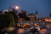 Ful moon and the Seine, Pont Neuf, Paris..July 15, 2011 - Photograph by Owen Franken