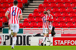Jordan Thompson of Stoke City is congratulated by James McClean of Stoke City after scoring a goal - Mandatory by-line: Nick Browning/JMP - 23/12/2020 - FOOTBALL - Bet365 Stadium - Stoke-on-Trent, England - Stoke City v Tottenham Hotspur - Carabao Cup