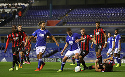 Birmingham City's Lukas Jutkiewicz and AFC Bournemouth's Marc Pugh (right, floor) battle for the ball during the Carabao Cup, Second Round match at St Andrew's, Birmingham.