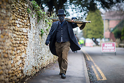 © Licensed to London News Pictures. 13/01/2018. Whittlesey UK. A member of Old Glory Molly this morning at the 39th Whittlesey Straw Bear Festival taking place today. In times past when starvation bit deep the ploughmen of the area where drawn to towns like Whittlesey, They knocked on doors begging for food & disguised their shame by blackening their faces with soot. In Whittlesey it was the custom on the Tuesday following Plough Monday to dress one of the confraternity of the plough in straw and call him a Straw Bear. The bear was then taken around town to entertain the folk who on the previous day had subscribed to the rustics, a spread of beer, tobacco & beef. The bear was made to dance in front of houses & gifts of money, beer & food was expected.Photo credit: Andrew McCaren/LNP