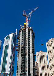 View of construction of  high-rise modern building towers in Marina at New Dubai in United Arab Emirates