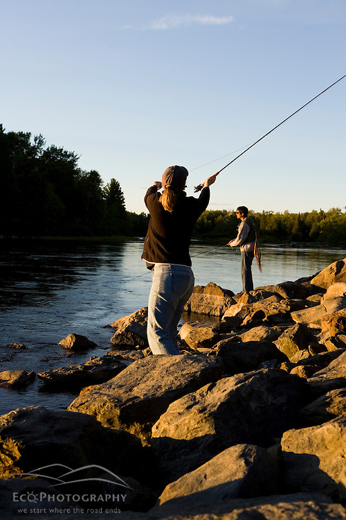 A couple fly-fishing on the Moose River in Rockwood Maine USA (MR)