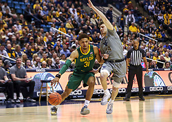Mar 7, 2020; Morgantown, West Virginia, USA; Baylor Bears guard MaCio Teague (31) dribbles against West Virginia Mountaineers guard Chase Harler (14) during the first half at WVU Coliseum. Mandatory Credit: Ben Queen-USA TODAY Sports