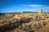 A well site at the Schreiber's Devil Springs Ranch in Blanco, New Mexico. <br /> The Schreiber's own over 400 acres and lease hundreds more from the BLM. They do not own their mineral rights so they have to contend with companies drilling and servicing wells on their land. They successfully took on industry and the BLM, persuading them to twin existing drill sites instead of drilling hundreds of new ones.