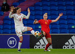 CARDIFF, WALES - Tuesday, April 13, 2021: Denmark's Nicoline Sørensen (L) challenges Wales' Rhiannon Roberts during a Women's International Friendly match between Wales and Denmark at the Cardiff City Stadium. (Pic by David Rawcliffe/Propaganda)