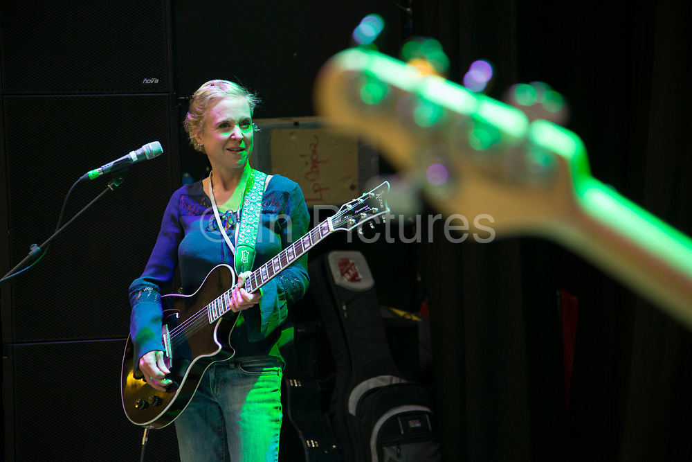 Lead singer and guitarist Kristin Hersh during soundcheck. Throwing Muses at the Islington Assembly Hall, London, UK. Throwing Muses are an alternative rock band founded in 1980. The group was originally fronted by two lead singers, Kristin Hersh, and Tanya Donelly. Known for performing music with shifting tempos, creative chord progressions, unorthodox song structures, and surreal lyrics, the group was set apart from other contemporary acts by Hersh's stark, writing style, David Narcizo's unusual drumming techniques almost totally without cymbals and Bernard Georges' driving baselines.